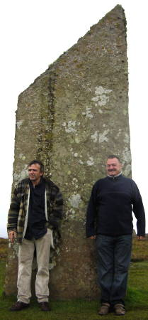 Kevin and Ray sheltering behind one of the Standing Stones of Brodgar